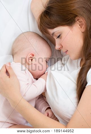 Young mother breastfeeds her baby. Breast-feeding, healthy baby nutrition. poster