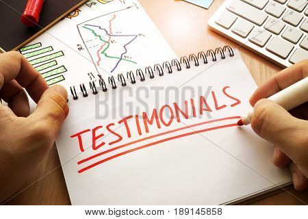 Testimonials written in a note. Client communication concept.