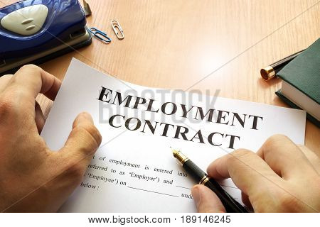 Employment contract on an office table. Recruitment concept.
