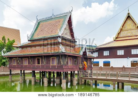 Ho Trai - Traditional Thai-style building used as a library that houses Buddhist scriptures (Tripitaka) located at Wat Mahathat Temple in downtown Yasothon northeastern (Isan) province of Thailand