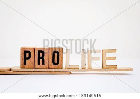 Pro Life in wooden letters on white background