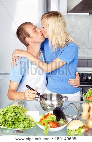 beautiful happy young couple cooking   in the kitchen at home