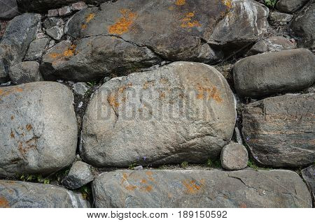 Texture of old wall of big stones in ancient Russian monastery