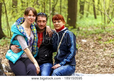Happy Family Preparing For Picnic At Campsite