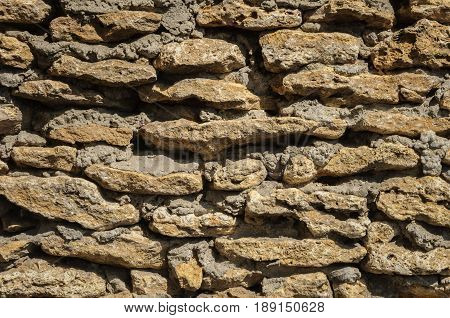 Wall of rough coquina stones. Shell stone textured wall.