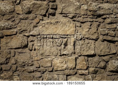 Texture of old brown stones wall surface