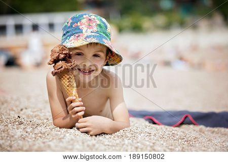 Sweet Little Child, Boy, Eating Ice Cream On The Beach