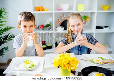 Happy children drink milk. food and drink concept, healthy food, indoor