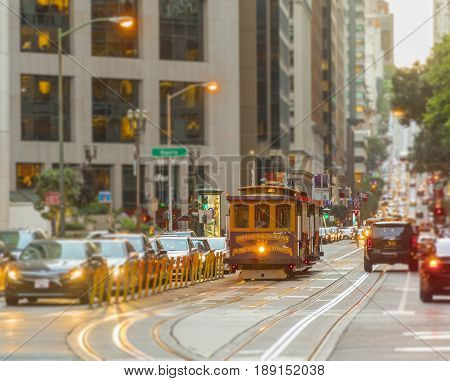 San Francisco, CA, USA, october 2016: San Francisco Cable Car on focus with blurred traffic on California Street at sunset