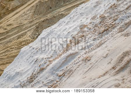 industrial sand quarry, sand pit, tyre tracks in sand, sand background, natural yellow abstract