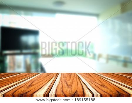 Selected focus empty brown wooden table and meeting room or office work blur background image. for your photomontage or product display.