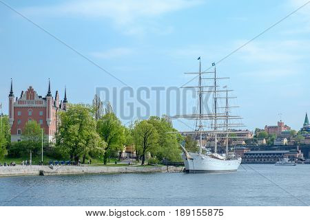 STOCKHOLM, SWEDEN - MAY 21. 2017: Admirality house and full-rigged sailing ship HMS af Chapman at Skeppsholmen island in Stockholm. The ship now serves as a youth hostel.