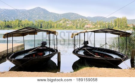 tourist boats resting on lake Bacina in Croatia