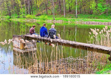 Vilnius, Lithuania - September 4 2014:  fishermen at the Pond in Traku Voke public park in Vilnius Lithuania.