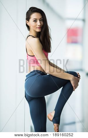 Sport Girl Standing In The Gym At The Window And Possing