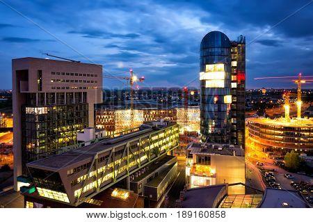 Business center under construction in Dusseldorf city at night. Nightscene Dusseldorf panorama photo