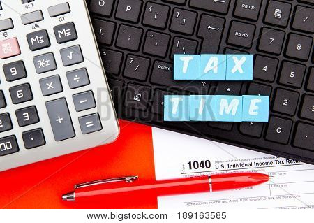 Tax Time - USA -  letters with 1040 Tax Form, calculator and keyboard