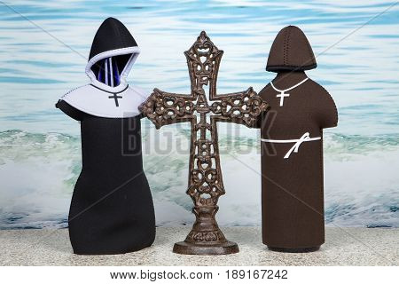 A religious themed still life against an ocean background