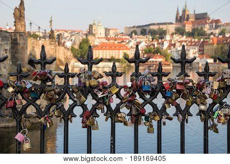 Love Locks On A Railing Near The Charles Bridge In Prague