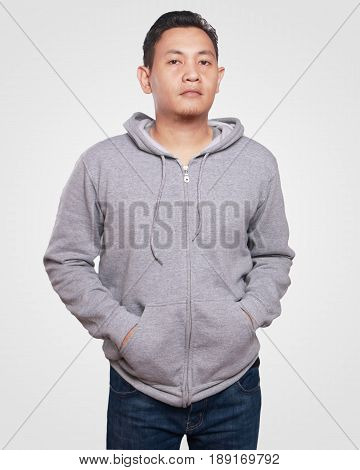 Blank sweatshirt mock up front view. Asian male model wear plain gray hoodie mockup. Hoody design presentation. Jumper for print. Blank clothes sweat shirt sweater