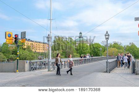 STOCKHOLM, SWEDEN - MAY 21, 2017: Skeppsholmen bridge to Skeppsholmen island in Stockholm. The capital city of Sweden is built on 17 islands.