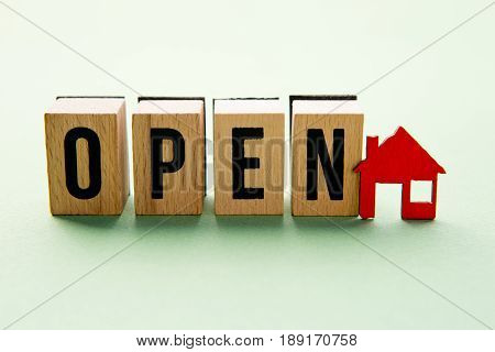 Open House - wooden block letters with red house icon