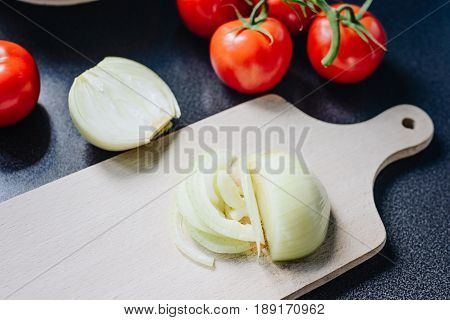 Chopped Onion On A Wooden Chopping Board