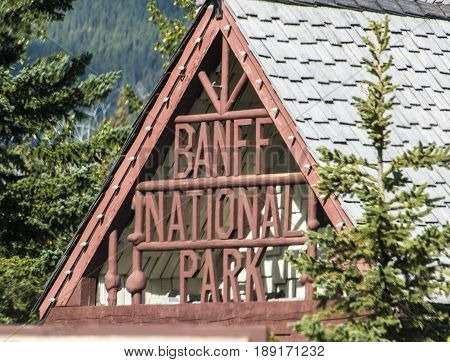 Alberta Canada - September 2015: The rustic Banff National Park entrance sign near Harvie Heights Alberta Canada.