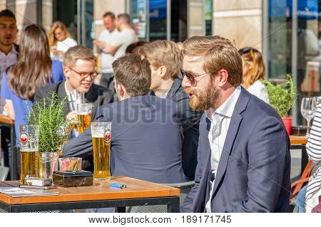 A Young Businessman At A Outdoor Bar In Canary Wharf