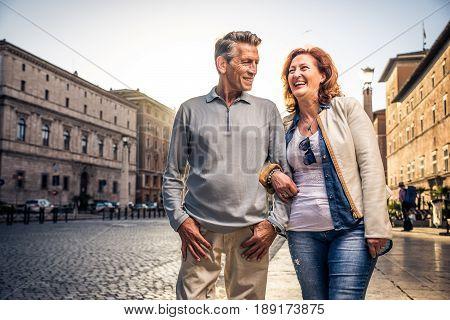 Senior couple at the Vaticano Rome - Happy tourists visiting italian famous landmarks