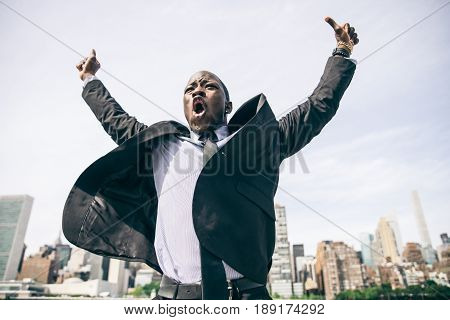 Confident happy businessman exulting - Happy man