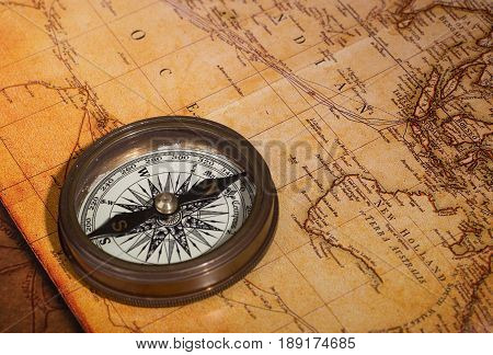 Brass compass on a vintage looking map