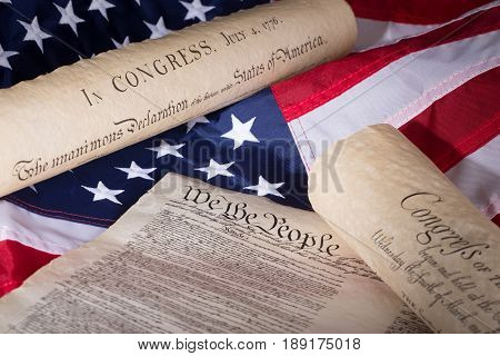 United States declaration of independence constitution and bill of rights on an american flag