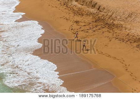 ARMACAO DE PERA, PORTUGAL - APRIL 24, 2017: Senhora da Rocha Beach, in the fishing village of Armacao de Pera, Algarve, Portugal
