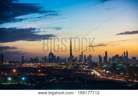 Dubai skyline and cityscape at sunset, UAE