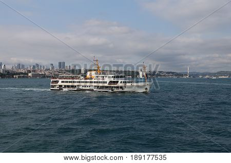 ISTANBUL TURKEY - MAY 27 2017: Sehir Hatlari ferry in Bosphorus Strait. Sehir Hatlari was established in 1844 and now carry 150000 passengers a day.