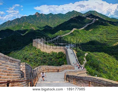 MUTIANNYU, BEIJING, CHINA, AUG,28, 2016: Famous ancient Great Wall of China monument with walking tourists people. China architecture holidays tours travel tourism. Chinese sightseeing point tours