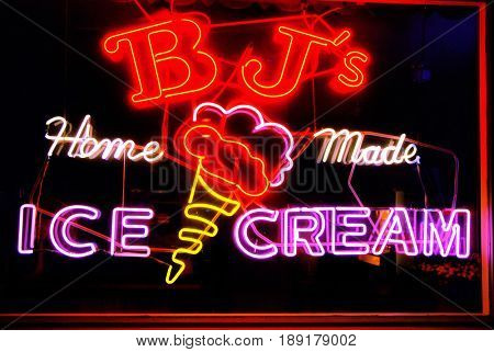 FLORENCE, OREGON, USA - September 28, 2009: BJâ??s Home Made Ice Cream neon sign hanging in a window