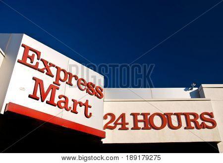 SACRAMENTO, CALIFORNIA, USA - November 14, 2009: Express Mart 24 Hours sign above a convenience store
