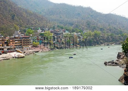 The holy river Ganges near Laxman Jhula in India Asia poster