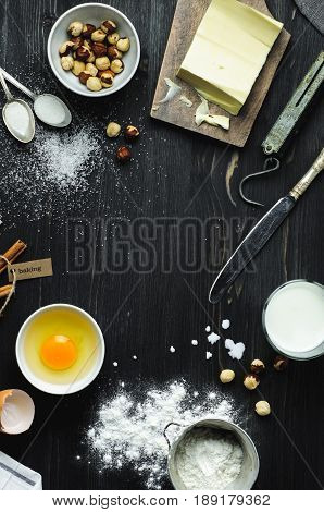 Baking Ingredients On A Dark Wood Background