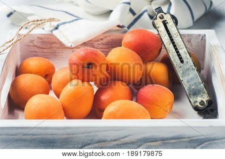 Fresh Apricots In A White Wooden Box