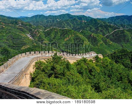 Perspective diagonal view on famous beautiful ancient Chinese Great Wall monument made of bricks stones. Old China architecture. China holidays vacation tours trips travel tourists. Sightseeing point