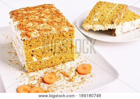sweet carrot cake dessert slices with cream from sour cream white wooden background