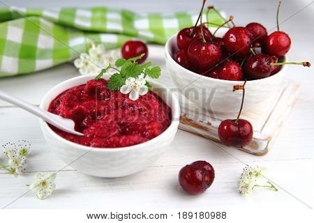 smoothie with fresh cherries in a white bowl