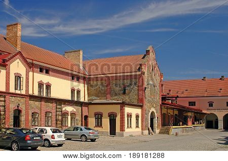 CZECH REPUBLIC, MAY 1, 2005: View on classic european czech beer factory with brown orange roofing, stone facade and architectural elements. Traditional beer factory architecture