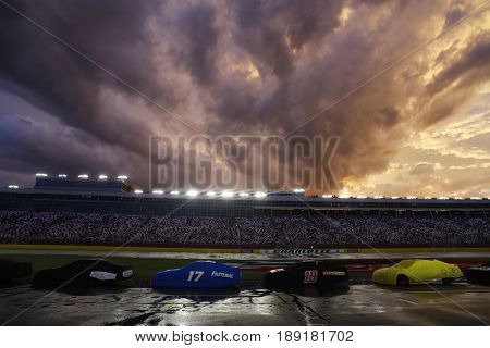 May 28, 2017 - Concord, NC, USA: The Monster Energy NASCAR Cup Series teams sit under a rain delay during the Coca Cola 600 at Charlotte Motor Speedway in Concord, NC.