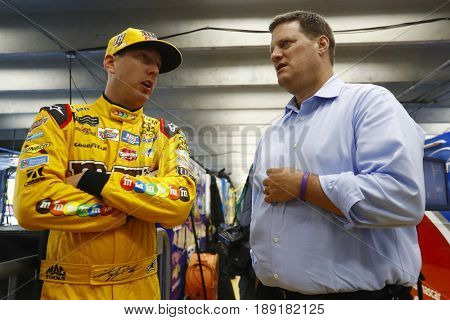 May 25, 2017 - Concord, NC, USA: Kyle Busch (18) and Steve O'Donnell hang out in the garage during qualifying for the Coca Cola 600 at Charlotte Motor Speedway in Concord, NC.
