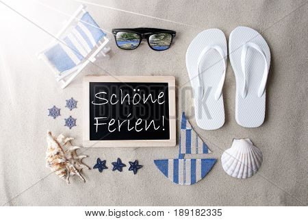 Flat Lay Of Chalkboard On Sandy Background. Sunny Summer Decoration As Holiday Greeting Card. Sand And Beach Environment. German Text Schoene Ferien Means Happy Holidays