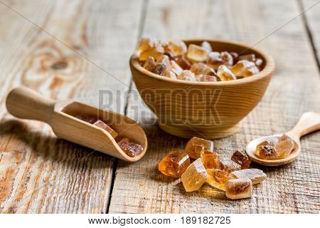 cooking sweets set with different sugar lumps on kitchen rustic table background close up